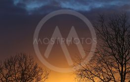 Vivid pictures of the sunset in the winter with the...