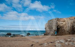 rock arch on beautiful cloudy sky background  at...