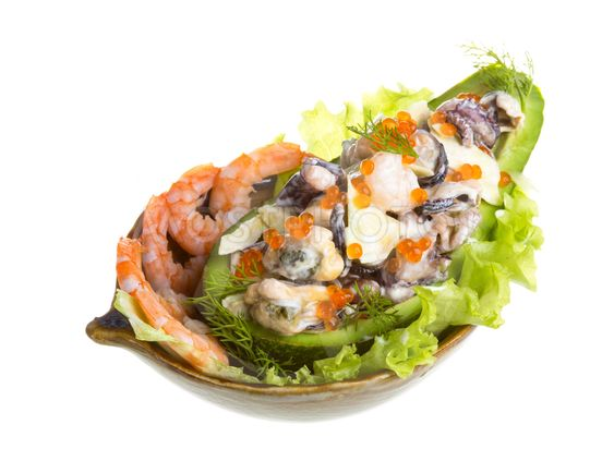 Seafood salad with red caviar in avocado