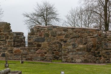 Stone wall and door at ruin of Ytterby old church