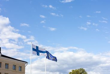 The Finnish and EU flags flapping in the wind