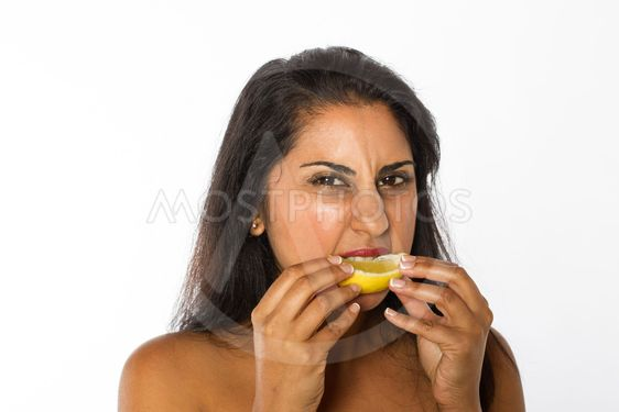 Indian Woman Eats Lemon
