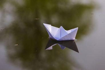 paper boat in the lake