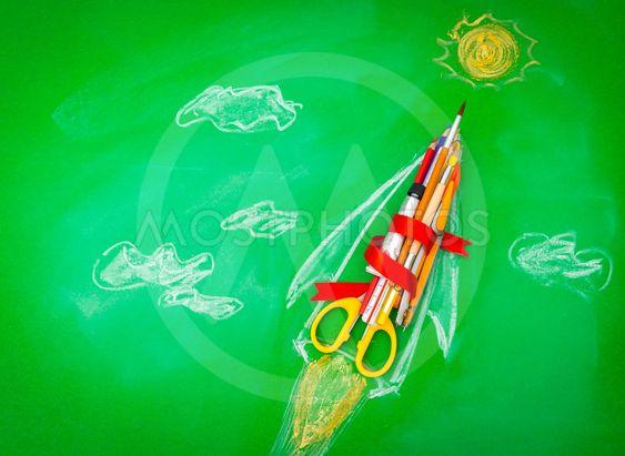 "Rocket made from School supplies on Green chalkboard ""..."