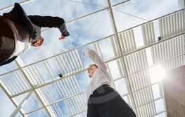 Two businesswomen celebrate cooperation