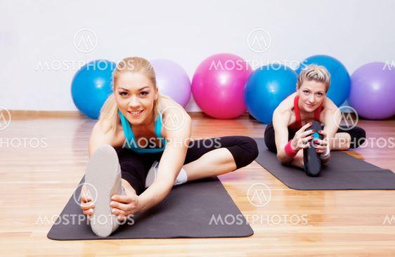 Two stretching girls