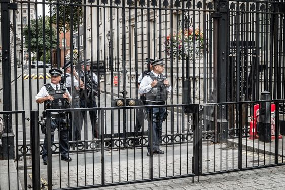 Policeman protecting 10 Downing Street in London