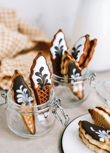 Sweet cookies in ice cream shape in glass jar on a table.