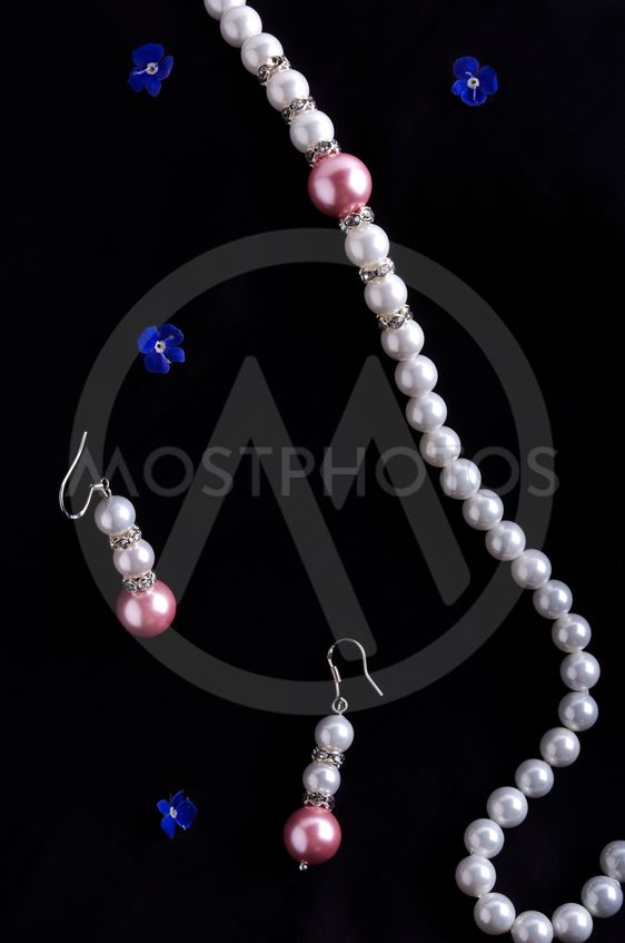Pearls necklace and earrings on black