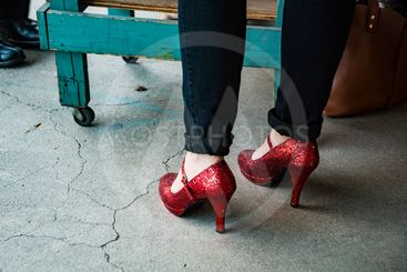 Woman wearing black pants and red high heel shoes