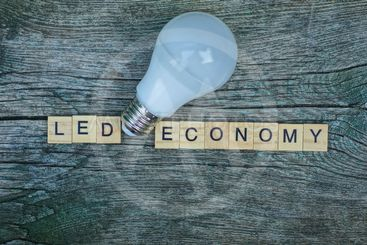 word led economy made of wooden letters