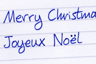 Writing Merry Christmas in French, Joyeux Noel.