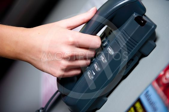Woman's hand holding telephone receiver