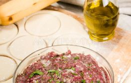 fresh raw dough and beef forcemeat