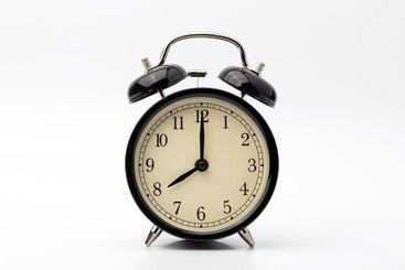 alarm clock shows eight o'clock