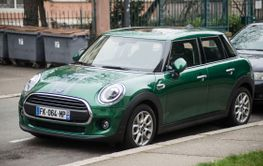Front view of green mini cooper parked in the street