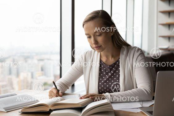 Smart female handwrite study online with books
