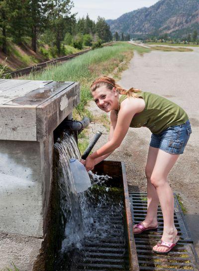 Teen Getting Spring Water