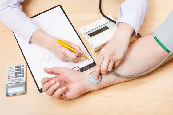physician measures blood pulse of patient