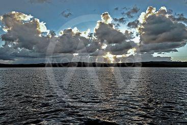 White and Blue colored coastal sunrise seascape cloudscape.