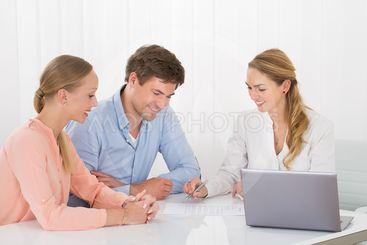 Advisor Showing Document To Couple