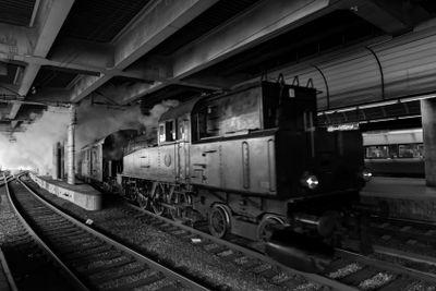 Old vintage steam train arriving at Stockholm cental...
