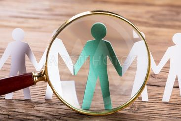 Magnifying Glass On Cut-out Figures