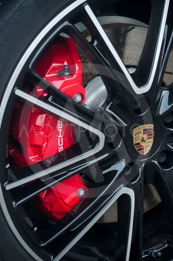 red break on wheel of Porsche sport car