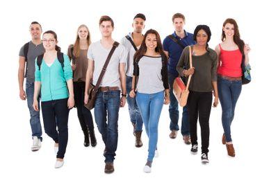 Confident University Students Walking Over White Background