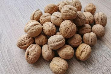 Whole walnuts on a wooden table