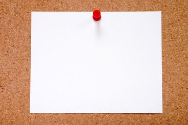 Blank paper stuck to a notice board, ready for your...