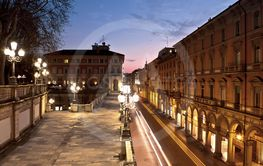 Night view of via Independenza from Montagnola Park,...