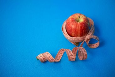 Red apple with centimeter tape