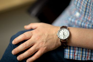 Classic men's timex watch matched to the left hand