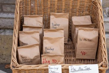 Basket with paper bags containing assorted kinds of tea