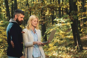Autumn couple. Business couple - browsing mobile...