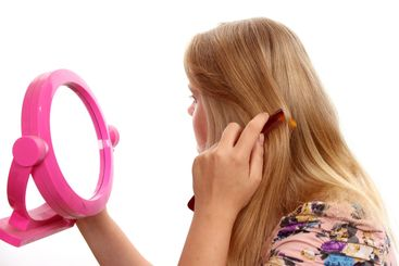 Young female combing her  hair