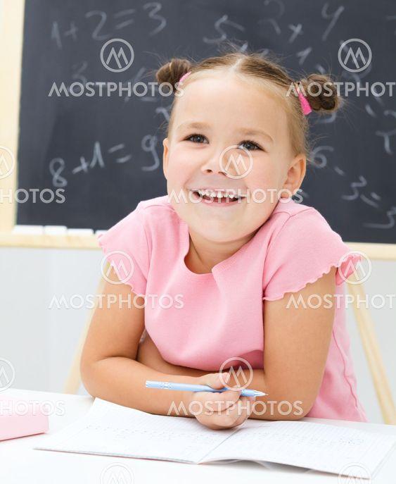 Portrait of a little girl in school