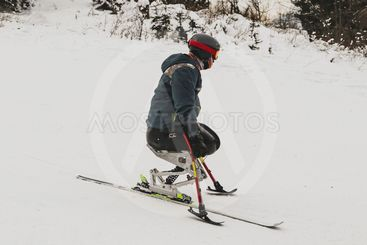 Invalid on a ski slope, competing.