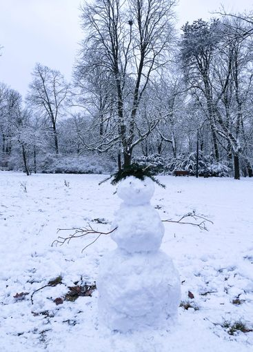 Snowman standing in the snow on a frosty winter day