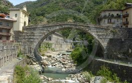 The ancient Roman bridge in the town of Pont St Martin...