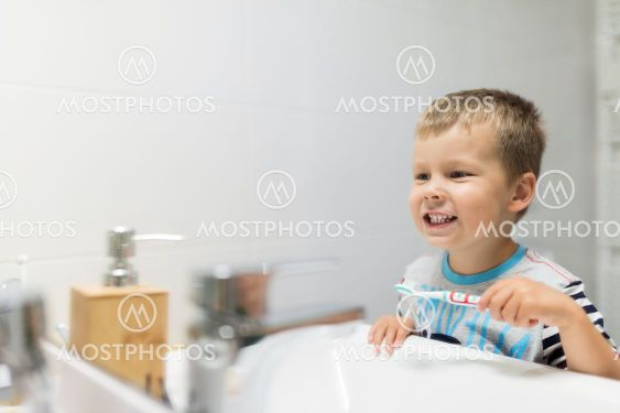 Adorable child brushing his teeth