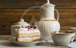 slice cake with white chocolate and cranberry on a plate