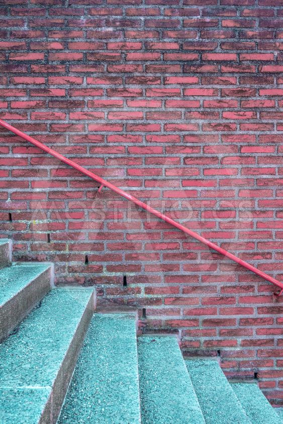 Stairway and brick wall with handrail