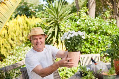 Senior man with flowers in his garden