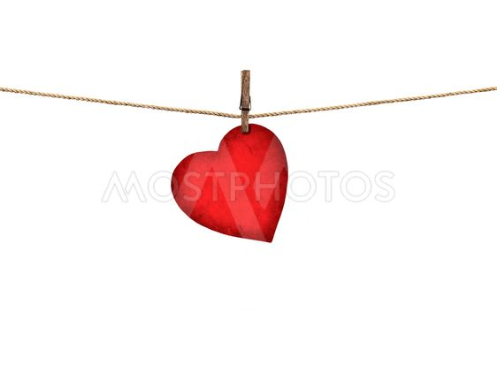 Valentine card heart shaped from old red paper hanging on...