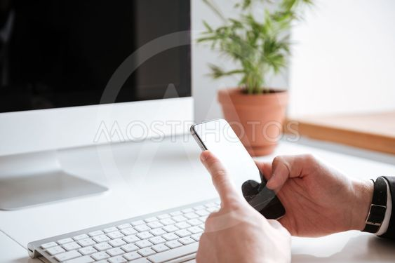 Cropped image of businessman chatting by phone.