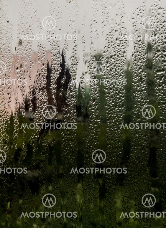 the view through the window of a country house in rainy...