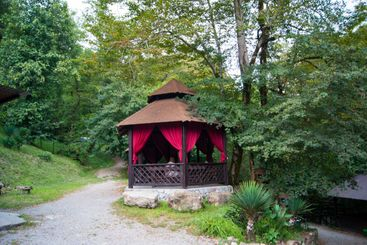 Open wooden brown gazebos in the mountains above the...