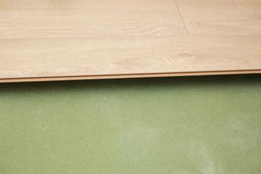 Installing wooden laminate or parquet floor in room over...